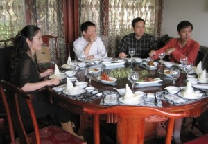 A typical banquet setting. Note: the small rice-wine toasting glasses. Do not be deceived. (This one from a 2012 visit at West Lake, Hongzhou)