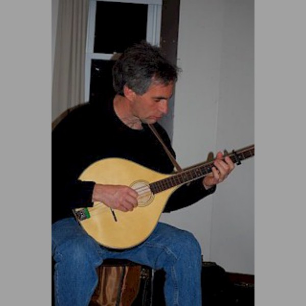 Tim Mowry, The Grumbling Rustics, plays a bouzouki.