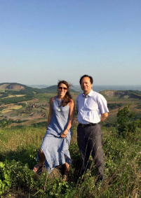 Daughter and poet Zhang Min-gui with caldera in background. Credit Mi Zheng-ying