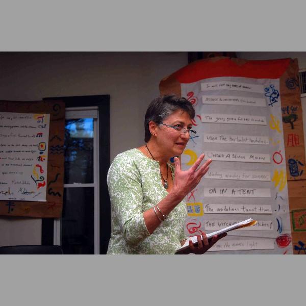 Clair Degutis, participants reading.