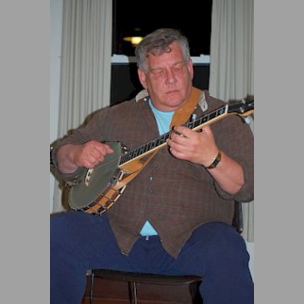 Steve Jones, of The Grumbling Rustics, on his banjo